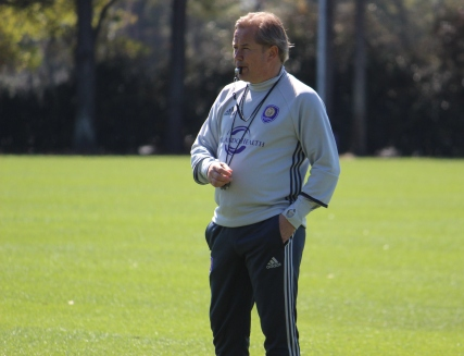Adrian Heath looks on at his squad during training prior to Orlando City SC's media day on Friday, February 26, 2016. (Mike Gramajo / Orlando Soccer Journal)