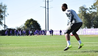 Earl Edwards Jr. prepares to block a shot during goalkeeper drills in training prior to Orlando City SC media day on Friday, February 26, 2016. (Victor Ng / Orlando Soccer Journal)