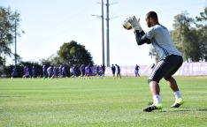 Earl Edwards Jr. blocks a shot during goalkeeper drills in training prior to Orlando City SC media day on Friday, February 26, 2016. (Victor Ng / Orlando Soccer Journal)