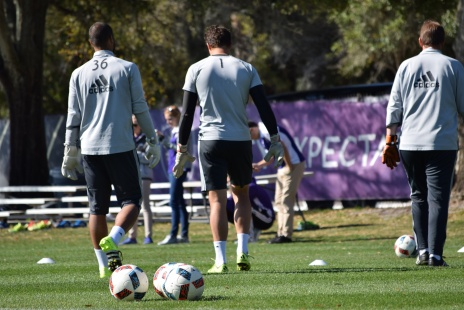 Goalkeepers Earl Edwards Jr. (36) and Joe Bendik (1) walk off the field with goalkeeper coach Stewart Kerr during training prior to Orlando City SC media day on Friday, February 26, 2016. (Victor Ng / Orlando Soccer Journal)