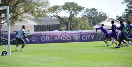 Earl Edwards Jr. (left) prepares to defend against a header during training prior to Orlando City SC's media day on Friday, February 26, 2016. (Victor Ng / Orlando Soccer Journal)