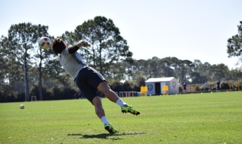 Joe Bendik dives to defend against a shot in goalkeeper drills during training prior to Orlando City SC's media day on Friday, February 26, 2016. (Victor Ng / Orlando Soccer Journal)
