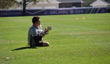 Joe Bendik blocks a low shot in goalkeeper drills during training prior to Orlando City SC's media day on Friday, February 26, 2016. (Victor Ng / Orlando Soccer Journal)