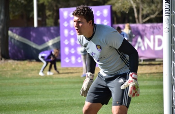 Joe Bendik prepares to block a shot in goalkeeper drills during training prior to Orlando City SC's media day on Friday, February 26, 2016. (Victor Ng / Orlando Soccer Journal)