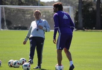 Adrian Heath (left) works with Ricardo Kaká (right) during training Ricardo Kaká looks on at his team during training prior to Orlando City SC's media day on Friday, February 26, 2016. (Mike Gramajo / Orlando Soccer Journal)