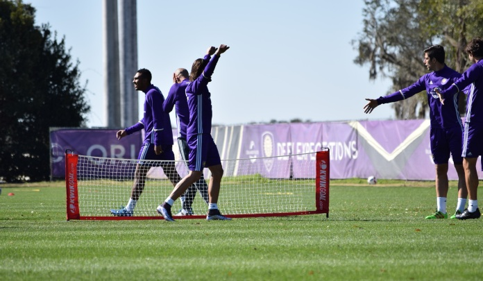 Players celebrate and complain following a result in soccer tennis during training prior to Orlando City SC's media day on Friday, February 26, 2016. (Victor Ng / Orlando Soccer Journal)