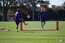 Servando Carrasco (left) and Brek Shea (right) warm up with soccer tennis during training prior to Orlando City SC's media day on Friday, February 26, 2016. (Victor Ng / Orlando Soccer Journal)