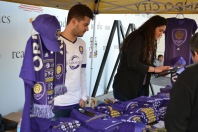 Fans purchase Orlando City SC merch at the Happy Hour event on Jan. 29, 2016. (Rosie Reitze / Orlando Soccer Journal).