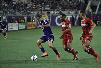 Adrian Winter (left) tries to escape defenders Arturo Alvarez (middle) and Johan Kappelhof in a match between Orlando City and the Chicago Fire in the Orlando Citrus Bowl on Friday, March 11, 2016. The match concluded in a 1-1 draw. (Victor Ng / Orlando Soccer Journal)