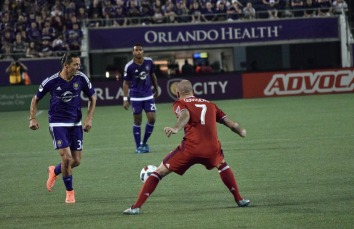 John Goossens (right) positions himself to attempt to halt Adrian Winter (left) in his tracks in the Orlando Citrus Bowl in a match between Orlando City and the Chicago Fire on Friday, March 11, 2016. The match concluded in a 1-1 draw. (Victor Ng / Orlando Soccer Journal)