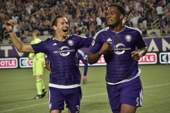 Adrian Winter (left) cheers on Cyle Larin (right) following his second goal of the season in a match between Orlando City and the Chicago Fire in the Orlando Citrus Bowl on Friday, March 11, 2016. The match concluded in a 1-1 draw. (Victor Ng / Orlando Soccer Journal)