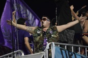 A fan from the supporters section rallies all fans for the all-match chants in a match between Orlando City and the Chicago Fire in the Orlando Citrus Bowl on Friday, March 11, 2016. The match concluded in a 1-1 draw. (Victor Ng / Orlando Soccer Journal)