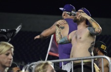 A fan in the supporters section encourages the rest of the fans during a match between Orlando City and the Chicago Fire in the Orlando Citrus Bowl on Friday, March 11, 2016. The match ended in a 1-1 draw. (Victor Ng / Orlando Soccer Journal)