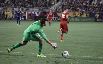 Joe Bendik rolls out a ball during a match between Orlando City and the Chicago Fire in the Orlando Citrus Bowl on Friday, March 11, 2016. The match ended in a 1-1 draw. (Victor Ng / Orlando Soccer Journal)