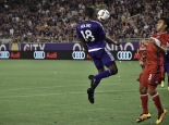 Kevin Molino (left) rises up to control the ball as Brandon Vincent (right) looks on in an Orlando City-Chicago Fire match on Friday, March 11, 2016. The match concluded in a 1-1 draw. (Victor Ng / Orlando Soccer Journal)