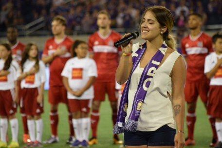 The National Anthem is sung in the Orlando Citrus Bowl prior to the start of the Orlando City-Chicago Fire match on Friday, March 11, 2016. (Victor Ng / Orlando Soccer Journal)