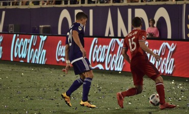Rafael Ramos (left) closes in on Joey Calistri (right) in a match between Orlando City and the Chicago Fire in the Orlando Citrus Bowl on Friday, March 11, 2016. The match ended in a 1-1 draw. (Victor Ng / Orlando Soccer Journal)