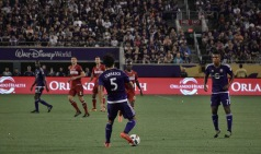 Servando Carrasco prepares to pass the ball to Cristian Higuita in a match between Orlando City and the Chicago Fire in the Orlando Citrus Bowl on Friday, March 11, 2016. The match ended in a 1-1 draw. (Victor Ng / Orlando Soccer Journal)