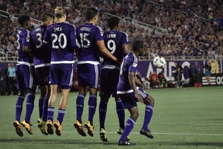 The Orlando City defense jumps to deflect a free kick during a Lions home match against the Chicago Fire in the Orlando Citrus Bowl on Friday, March 11, 2016. The match ended in a 1-1 draw. (Victor Ng / Orlando Soccer Journal)